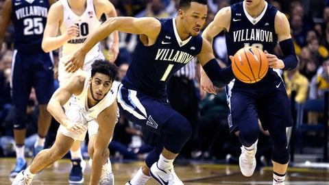 Villanova's Jalen Brunson steals the ball as Marquette's Markus Howard looks on during the second half of an NCAA college basketball game Sunday, Jan. 28, 2018, in Milwaukee. (AP Photo/Tom Lynn)