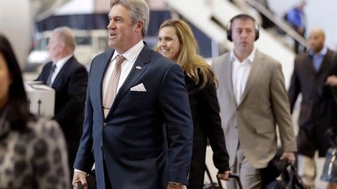 Philadelphia Eagles head coach Doug Pederson, left, arrives with his team for the NFL Super Bowl 52 football game Sunday, Jan. 28, 2018, in Minneapolis. Philadelphia a a scheduled to face the New England Patriots. (AP Photo/Eric Gay)