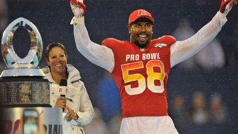 AFC linebacker Von Miller (58), of the Denver Broncos, raises his hands after winning the MVP Defensive Player of the game, at the NFL Pro Bowl football game against the NFC, Sunday, Jan. 28, 2018, in Orlando, Fla. The AFC defeated the NFC 24-23. (AP Photo/Steve Nesius)