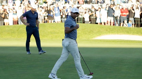 Jason Day, of Australia, front, reacts after making his putt as Alex Noren, of Sweden, looks on during the second playoff hole on the 18th hole of the South Course at Torrey Pines Golf Course during the final round of the Farmers Insurance Open golf tournament, Sunday, Jan. 28, 2018, in San Diego. (AP Photo/Gregory Bull)