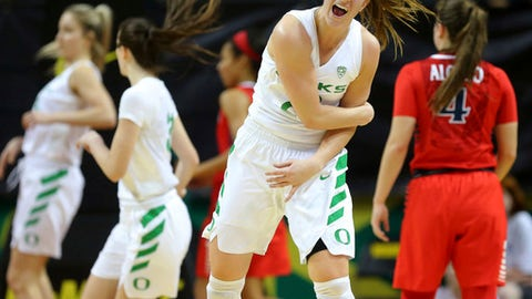 FLE - In this Jan. 12, 2018, file photo, Oregon's Sabrina Ionescu celebrates the first of her four 3-pointers against Arizona during an NCAA college basketball game in Eugene, Ore. Ionescu increased her NCAA record with her ninth career triple-double in a win over Utah on Sunday, Jan. 29. (Brian Davies/The Register-Guard via AP, File)