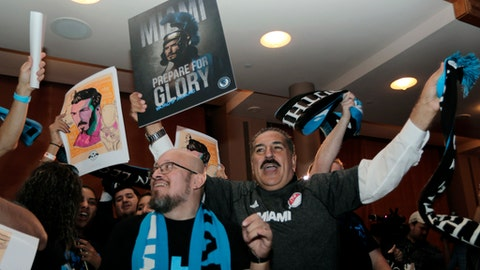 Soccer fans celebrate before an announcement by Major League Soccer that an MLS expansion team is coming to Miami, backed by David Beckham and investors, Monday, Jan. 29, 2018, in Miami. (AP Photo/Lynne Sladky)