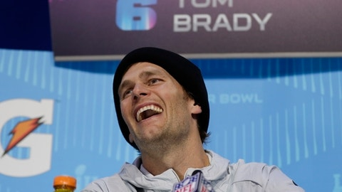 New England Patriots' Tom Brady laughs during NFL football Super Bowl 52 Opening Night Monday, Jan. 29, 2018, at the Xcel Center in St. Paul, Minn. (AP Photo/Matt Slocum)