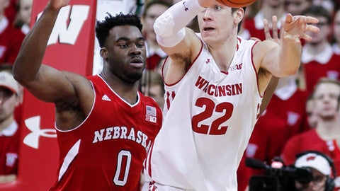 Wisconsin's Ethan Happ (22) passes against Nebraska's Duby Okeke (0) during the first half of an NCAA college basketball game Monday, Jan. 29, 2018, in Madison, Wis. (AP Photo/Andy Manis)