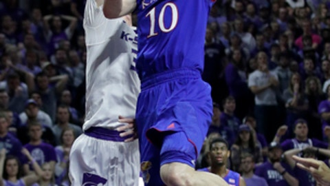 Kansas guard Sviatoslav Mykhailiuk (10) drives for a basket against Kansas State forward Dean Wade, left, during the first half of an NCAA college basketball game in Manhattan, Kan., Monday, Jan. 29, 2018. (AP Photo/Orlin Wagner)