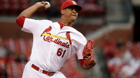 FILE - In this Sept. 29, 2016, file photo, St. Louis Cardinals starting pitcher Alex Reyes throws during the first inning of a baseball game against the Cincinnati Reds in St. Louis. As the top pitching prospect in baseball, Reyes was expected to play a vital role on the Cardinals pitching staff last season. However, the flame-throwing right-hander missed the entire season following elbow surgery during spring training, but he's back and in the best shape of his career and trying to re-establish himself this year.(AP Photo/Jeff Roberson, File)