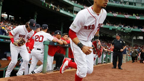 FILE - In this Oct. 9, 2017, file photo, Boston Red Sox's Mookie Betts runs onto the field for Game 4 of baseball's American League Division Series against the Houston Astros in Boston. Betts and the Red Sox have argued the first salary arbitration case of the year, with the All-Star outfielder asking for a raise from $950,000 to $10.5 million and the team offering $7.5 million. Arbitrators Dan Brent, Mark Burstein, Phillip LaPorte heard arguments Tuesday, Jan. 30, 2018, and a decision is expected Wednesday. (AP Photo/Michael Dwyer, File)