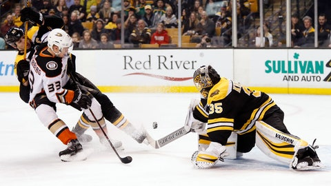 Anaheim Ducks' Jakob Silfverberg (33) knocks the puck past Boston Bruins goaltender Anton Khudobin for a goal during the first period of an NHL hockey game in Boston on Tuesday, Jan. 30, 2018. (AP Photo/Winslow Townson)