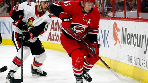Carolina Hurricanes' Jeff Skinner (53) works the puck agains Ottawa Senators' Fredrik Claesson (33) during the second period of an NHL hockey game, Tuesday, Jan. 30, 2018, in Raleigh, N.C. (AP Photo/Karl B DeBlaker)