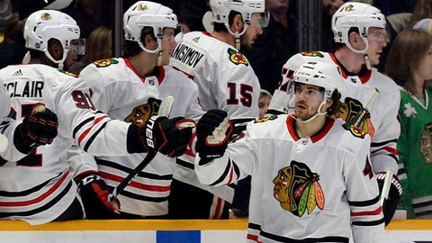Chicago Blackhawks left wing Vinnie Hinostroza (48) is congratulated after scoring a goal against the Nashville Predators during the second period of an NHL hockey game Tuesday, Jan. 30, 2018, in Nashville, Tenn. (AP Photo/Mark Zaleski)