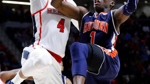 Auburn guard Jared Harper (1) attempts a layup past Mississippi guard Breein Tyree (4) during the first half of the NCAA college basketball game in Oxford, Miss., Tuesday, Jan. 30, 2018. (AP Photo/Rogelio V. Solis)