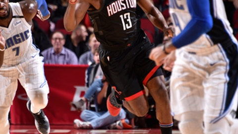 HOUSTON, TX - JANUARY 30:  James Harden #13 of the Houston Rockets handles the ball against the Orlando Magic on January 30, 2018 at the Toyota Center in Houston, Texas. NOTE TO USER: User expressly acknowledges and agrees that, by downloading and or using this photograph, User is consenting to the terms and conditions of the Getty Images License Agreement. Mandatory Copyright Notice: Copyright 2018 NBAE (Photo by Bill Baptist/NBAE via Getty Images)