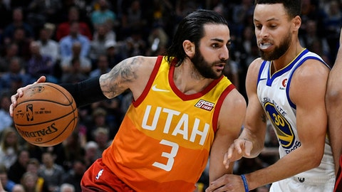 SALT LAKE CITY, UT - JANUARY 30: Ricky Rubio #3 of the Utah Jazz drives around Stephen Curry #30 of the Golden State Warriors during the first half of a game at Vivint Smart Home Arena on January 30, 2018 in Salt Lake City, Utah. NOTE TO USER: User expressly acknowledges and agrees that, by downloading and or using this photograph, User is consenting to the terms and conditions of the Getty Images License Agreement. (Photo by Gene Sweeney Jr./Getty Images)