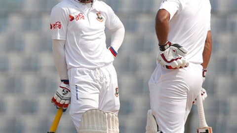 Bangladesh's Mominul Haque, left, and teammate Imrul Kayes talk, as they bat during the first day of the first test cricket match against Sri Lanka in Chittagong, Bangladesh, Wednesday, Jan. 31, 2018. (AP Photo/A.M. Ahad)