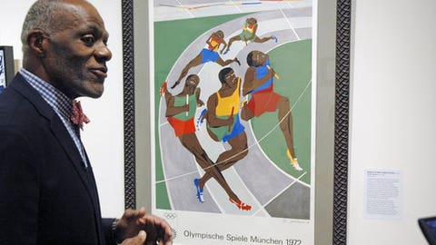 In this Jan. 11, 2018 photo, Alan Page, NFL Hall of Famer and retired Minnesota Supreme Court justice, talks about a poster from the 1972 Olympics in Munich that was done by an African-American artist, which is among the artifacts of slavery and segregation collected by Page and his wife, Diane Sims Page. They went on display at the Minneapolis Central Library in time for Super Bowl visitors and thousands of other people expected to flock to downtown for the festivities. (AP Photo/Steve Karnowski)