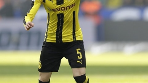 "FILE - In this March 11, 2017 file photo Dortmund's Marc Bartra plays the ball during the German Bundesliga soccer match between Hertha BSC Berlin and Borussia Dortmund in Berlin, Germany. Spanish defender Bartra is leaving Borussia Dortmund to join La Liga side Real Betis. Dortmund says it has made a ""big concession"" on the transfer fee to allow Bartra return to Spain after what has been a tumultuous one and half Bundesliga seasons. (AP Photo/Michael Sohn, file)"