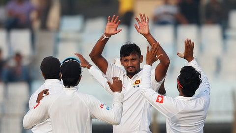 Sri Lanka's Suranga Lakmal, second right, celebrate with his teammates the dismissal of Bangladesh's Mushfiqur Rahim during the first day of the first test cricket match against Bangladesh in Chittagong, Bangladesh, Wednesday, Jan. 31, 2018. (AP Photo/A.M. Ahad)