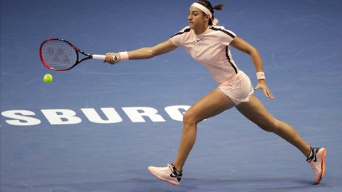 Caroline Garcia of France returns the ball to Elena Rybakina of Russia during the St. Petersburg Ladies Trophy-2018 tennis tournament match in St.Petersburg, Russia, Wednesday, Jan. 31, 2018. (AP Photo/Dmitri Lovetsky)