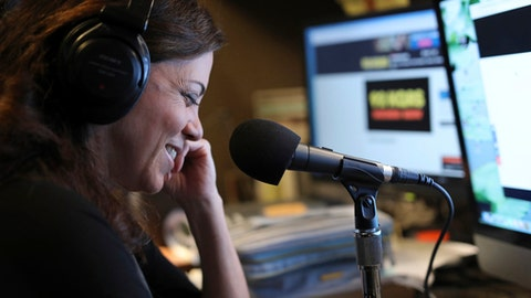 In an Aug. 28, 2017 photo, Michele Tafoya, sideline reporter for NBC Sunday Night Football,  works from her home studio in Edina, Minn., on the morning radio show lives in Edina with her husband and two children. She recently joined Tom Barnard on the popular KQ Morning Show.   (Brian Peterson/Star Tribune via AP)