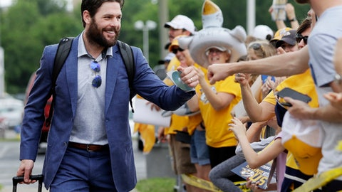 FILE - In this May 27, 2017, file photo, Nashville Predators center and team captain Mike Fisher is greeted by fans as players arrive at the airport in Nashville, for a trip to Pittsburgh for the Stanley Cup Finals. Predators general manager David Poile announced Wednesday, Jan. 31, 2018, that Fisher is coming out of retirement to make a comeback and play once more. The team hopes to sign a contract around the Feb. 26 trade deadline. (AP Photo/Mark Humphrey, File)