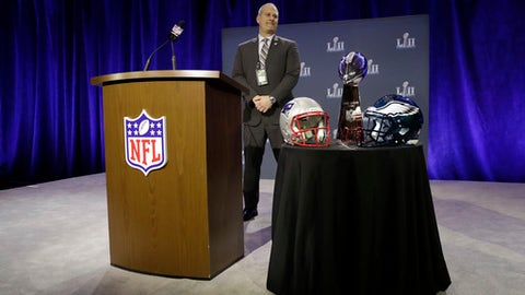 Security specialist James Contreras watches over the Vince Lombardi Trophy before a news conference by Commissioner Roger Goodell in advance of the Super Bowl 52 football game, Wednesday, Jan. 31, 2018, in Minneapolis. The Philadelphia Eagles play the New England Patriots on Sunday, Feb. 4, 2018. (AP Photo/Matt Slocum)