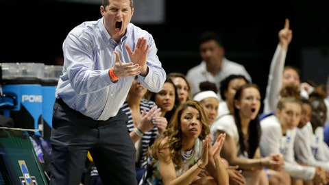 FILE - In this March 18, 2017, file photo, Florida Gulf Coast head coach Karl Smesko shouts during the second half of a first round game against Miami in the NCAA women's college basketball tournament in Coral Gables, Fla.  Out of the 350 or so Division I basketball schools, only one is still unbeaten in both men's and women's conference play, and it's FGCU, which got on the NCAA map as Dunk City a few years ago and hasn't lost steam since.(AP Photo/Lynne Sladky, File)