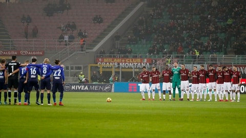 Players observe a minute of silence to remember late Azeglio Vicini, prior to the Italian Cup, first-leg semifinal soccer match between AC Milan and Lazio, at the Milan San Siro stadium, Italy, Wednesday, Jan. 31, 2018. (AP Photo/Antonio Calanni)