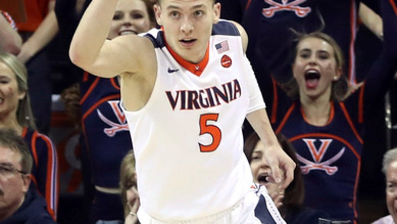 No. 2 Virginia holds off Louisville 74-64