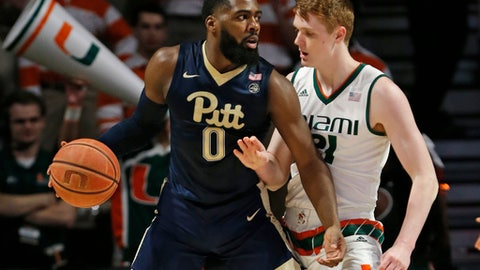 Pittsburgh guard Jared Wilson-Frame (0) drives up against Miami forward Sam Waardenburg (21) during the first half of an NCAA college basketball game, Wednesday, Jan. 31, 2018, in Coral Gables, Fla. (AP Photo/Wilfredo Lee)