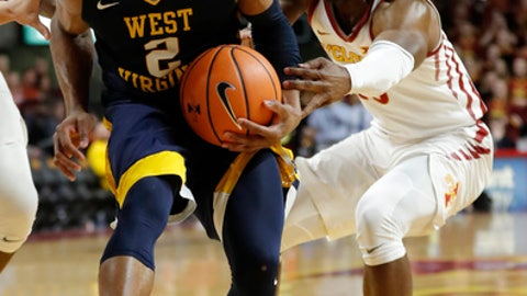 West Virginia guard Jevon Carter (2) drives past Iowa State guard Jakolby Long, right, during the first half of an NCAA college basketball game Wednesday, Jan. 31, 2018, in Ames, Iowa. (AP Photo/Charlie Neibergall)