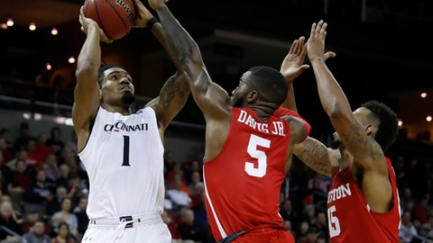 Cincinnati's Jacob Evans (1) shoots against Houston's Corey Davis Jr. (5) and Devin Davis (15) during the first half of an NCAA college basketball game Wednesday, Jan. 31, 2018, in Highland Heights, Ky. (AP Photo/John Minchillo)