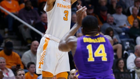 Tennessee guard James Daniel III (3) shoots over LSU guard Randy Onwuasor during the second half of an NCAA college basketball game Wednesday, Jan. 31, 2018, in Knoxville, Tenn. (AP Photo/Crystal LoGiudice)