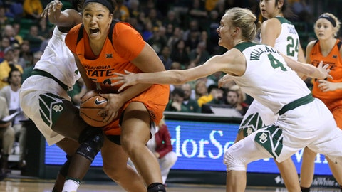 Oklahoma State center Kaylee Jensen, left, pulls in a rebound over Baylor guard Kristy Wallace, right, during the first half of an NCAA college basketball game, Wednesday, Jan. 31, 2018, in Waco, Texas. (AP Photo/Rod Aydelotte)