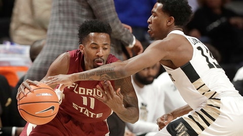 Florida State's Braian Angola (11) drives against Wake Forest's Bryant Crawford (13) during the first half of an NCAA college basketball game in Winston-Salem, N.C., Wednesday, Jan. 31, 2018. (AP Photo/Chuck Burton)