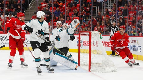San Jose Sharks goaltender Martin Jones (31) catches the puck in the air after a deflection against the Detroit Red Wings in the second period of an NHL hockey game Wednesday, Jan. 31, 2018, in Detroit. (AP Photo/Paul Sancya)