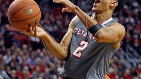 Texas Tech's Zhaire Smith (2) loses the ball as he's fouled during the first half of an NCAA college basketball game against Texas, Wednesday, Jan. 31, 2018, in Lubbock, Texas. (AP Photo/Brad Tollefson)