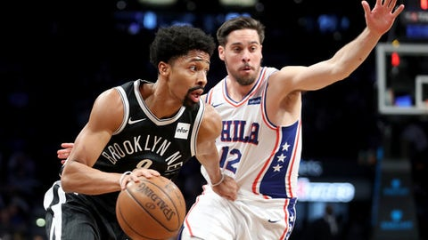 NEW YORK, NY - JANUARY 31: Spencer Dinwiddie #8 of the Brooklyn Nets works against T.J. McConnell #12 of the Philadelphia 76ers in the second quarter during their game at Barclays Center on January 31, 2018 in the Brooklyn borough of New York City. NOTE TO USER: User expressly acknowledges and agrees that, by downloading and or using this photograph, User is consenting to the terms and conditions of the Getty Images License Agreement.  (Photo by Abbie Parr/Getty Images)
