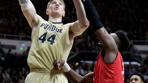 Purdue center Isaac Haas (44) shoots over Maryland forward Bruno Fernando (23) during the second half of an NCAA college basketball game in West Lafayette, Ind., Wednesday, Jan. 31, 2018. Purdue defeated Maryland 75-67. (AP Photo/Michael Conroy)