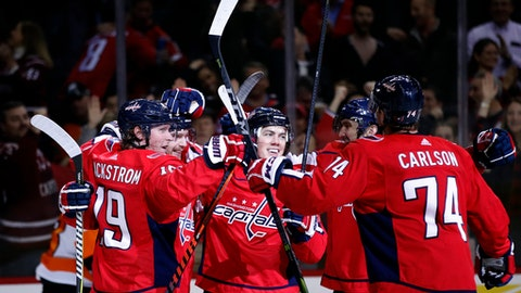 Washington Capitals right wing T.J. Oshie, center, celebrates with teammates after his goal during the third period of an NHL hockey game against the Philadelphia Flyers, Wednesday, Jan. 31, 2018, in Washington. The Capitals won 5-3. (AP Photo/Alex Brandon)