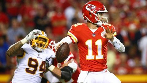 Oct 2, 2017; Kansas City, MO, USA; Kansas City Chiefs quarterback Alex Smith (11) throws a pass as Washington Redskins linebacker Preston Smith (94) defends in the second half at Arrowhead Stadium. Mandatory Credit: Jay Biggerstaff-USA TODAY Sports
