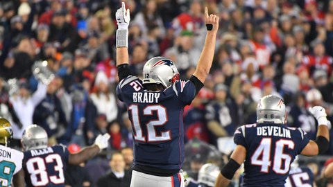 Jan 21, 2018; Foxborough, MA, USA; New England Patriots quarterback Tom Brady (12) celebrates after a first down by running back Dion Lewis (33) picks up a first down in the fourth quarter in the AFC Championship Game against the Jacksonville Jaguars at Gillette Stadium. Mandatory Credit: Robert Deutsch-USA TODAY Sports