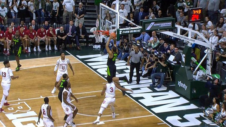 Michigan State's Miles Bridges slams home the alley oop to finish off the fast break