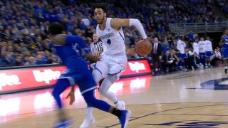 Creighton's Ronnie Harrell Jr. goes behind the back to fool the defender on his way to the rim