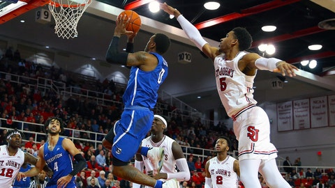 Jan 23, 2018; Queens, NY, USA; Creighton Bluejays guard Marcus Foster (0) takes a shot while being defended by St. John's Red Storm guard Justin Simon (5) during the first half at Carnesecca Arena. Mandatory Credit: Andy Marlin-USA TODAY Sports