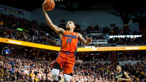 Jan 6, 2018; Columbia, MO, USA; Florida Gators guard Chris Chiozza (11) puts in the game-winning layup against the Missouri Tigers during the second half at Mizzou Arena. Mandatory Credit: Amy Kontras-USA TODAY Sports