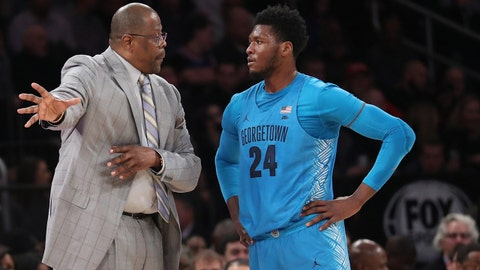Jan 9, 2018; New York, NY, USA; Georgetown Hoyas head coach Patrick Ewing (L) talks with forward Marcus Derrickson (24) during the first half against the St. John's Red Storm at Madison Square Garden. Mandatory Credit: Anthony Gruppuso-USA TODAY Sports
