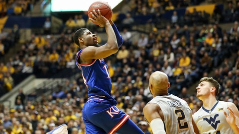 Jan 15, 2018; Morgantown, WV, USA; Kansas Jayhawks guard Malik Newman (14) shoots in the lane during the first half against the West Virginia Mountaineers at WVU Coliseum. Mandatory Credit: Ben Queen-USA TODAY Sports