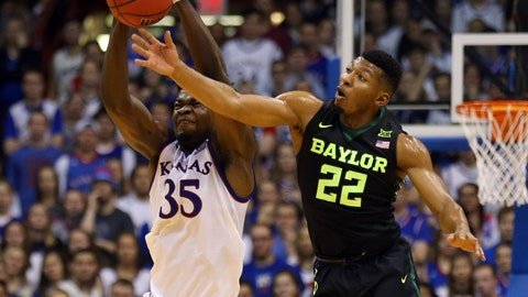 Jan 20, 2018; Lawrence, KS, USA; Kansas Jayhawks center Udoka Azubuike (35) and Baylor Bears guard King McClure (22) fight for a loose ball in the first half at Allen Fieldhouse. Mandatory Credit: Jay Biggerstaff-USA TODAY Sports