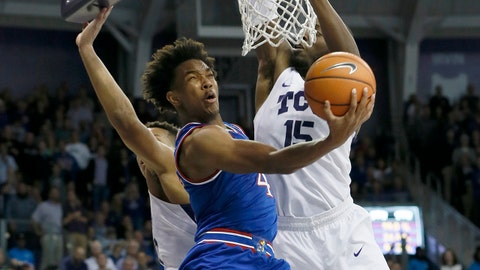Jan 6, 2018; Fort Worth, TX, USA; Kansas Jayhawks guard Devonte' Graham (4) shoots a reverse layup against TCU Horned Frogs forward JD Miller (15) in the second half at Ed and Rae Schollmaier Arena. Mandatory Credit: Tim Heitman-USA TODAY Sports