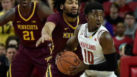 Jan 18, 2018; College Park, MD, USA; Maryland Terrapins guard Darryl Morsell (10) looks to pass as Minnesota Golden Gophers forward Jordan Murphy (3) defends during the first half at XFINITY Center. Mandatory Credit: Tommy Gilligan-USA TODAY Sports
